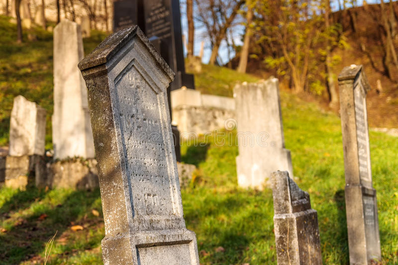 Tomb stone at jewish cemetery below medieval castle Beckov stock photography