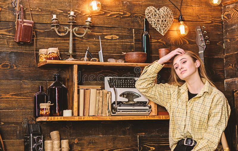 Tomboy concept. Lady on dreamy face in plaid clothes looks cute and casual. Girl tomboy spend time in house of. Gamekeeper. Girl in casual outfit in wooden stock images