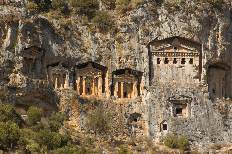 Tombs of ancient Lykia kings. View on the tombs of ancient Likya kings carved out in the rock stock image