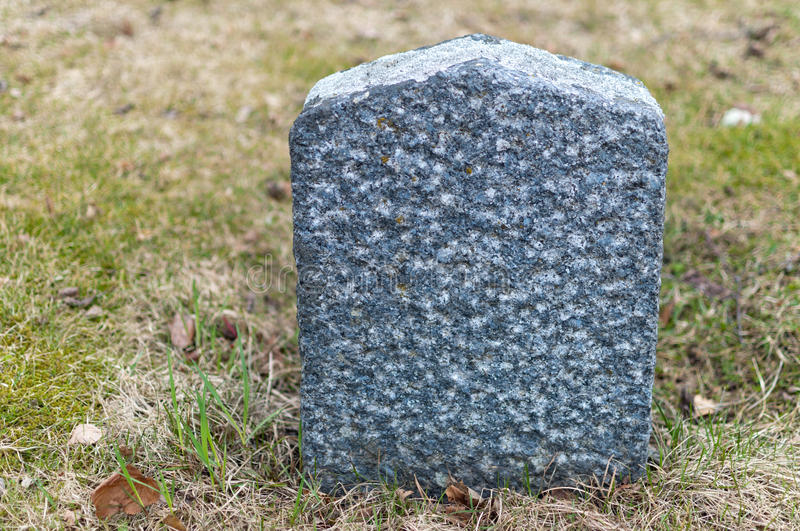 Tombstone. An old small empty tombstone on a graveyard royalty free stock photography