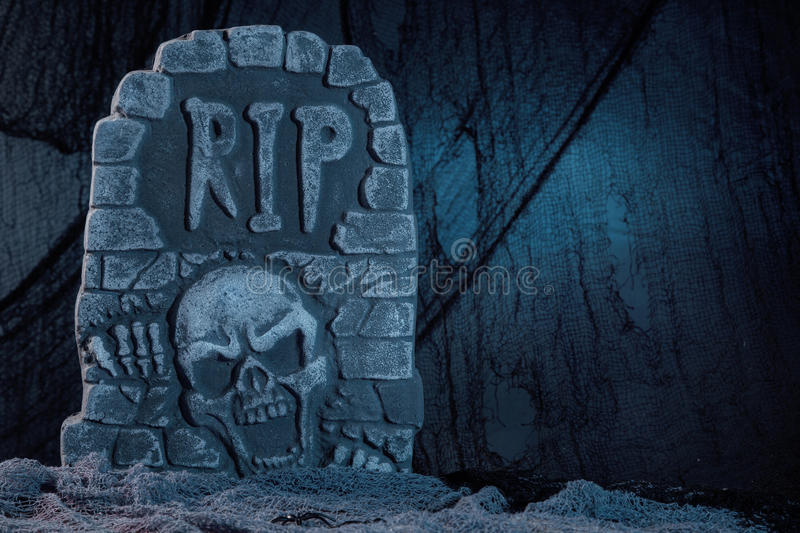 Tombstone. With skull halloween decoration royalty free stock photos