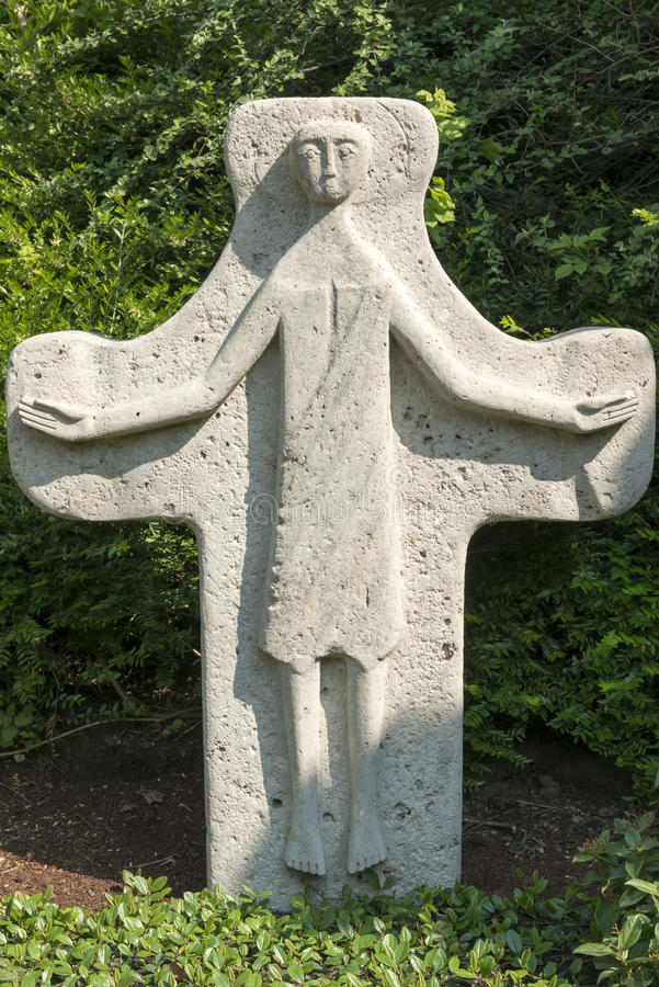Tombstone Cross. With abstracted Jesus representation stock photography