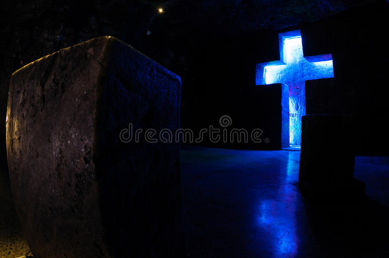 Tombstone and cross with blue light in salt. Cathedral Zipaquira near Bogota, Colombia stock photos