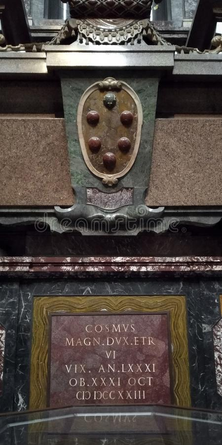 The tombstone of Duke Cosimo IV Medici, Florence. FLORENCE, ITALY - SEPTEMBER 13, 2018: This is the tombstone of Duke Cosimo IV and the Medici emblem in the stock image