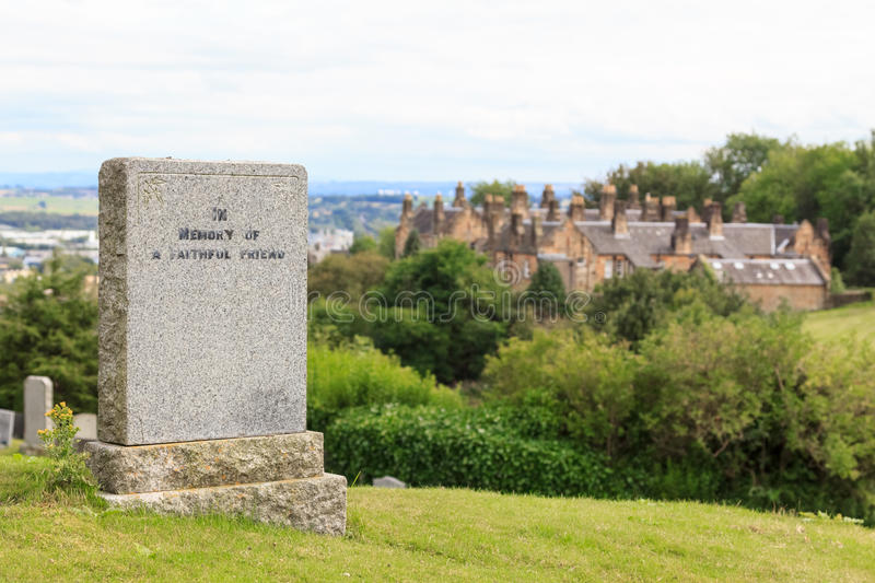 Tombstone on a hill. A tombstone in memory of a faithful friend on a hill in Stirling, Scotland stock image