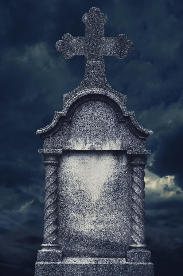 Tombstone. Old tombstone at night. halloween concept stock photo