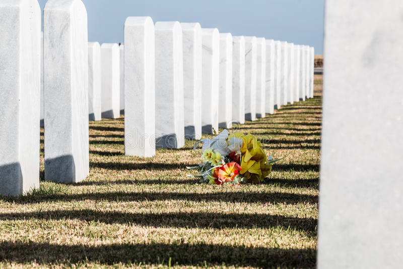 Tombstones and Flowers at Miramar National Cemetery. Row of tombstones with bouquet of flowers at Miramar National Cemetery in San Diego, California stock photos