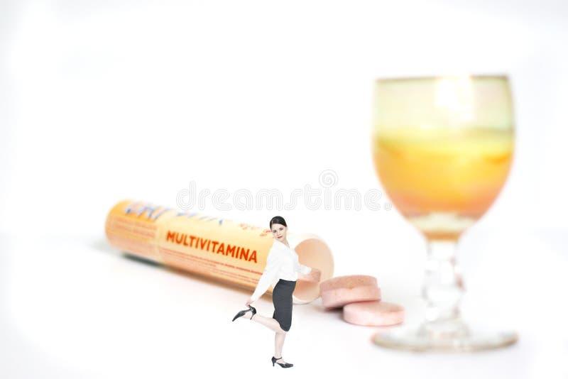 Tome as vitaminas   fotografia de stock royalty free