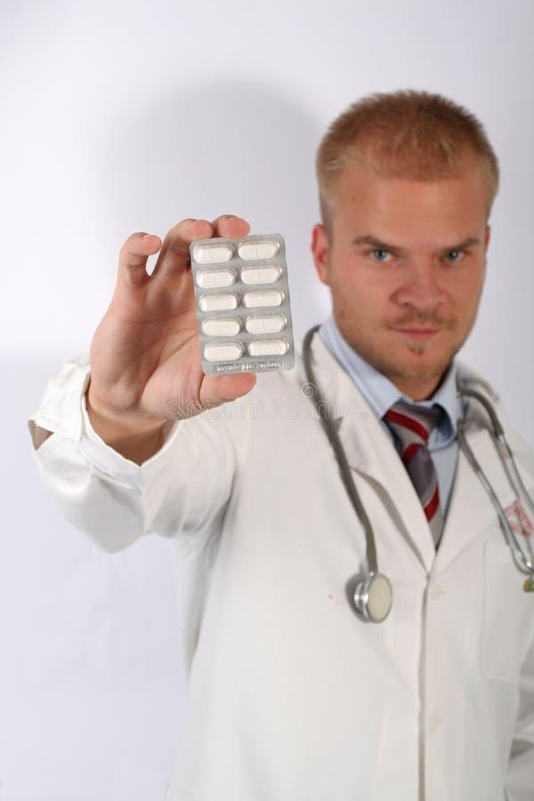 Tome una píldora imagen de archivo libre de regalías