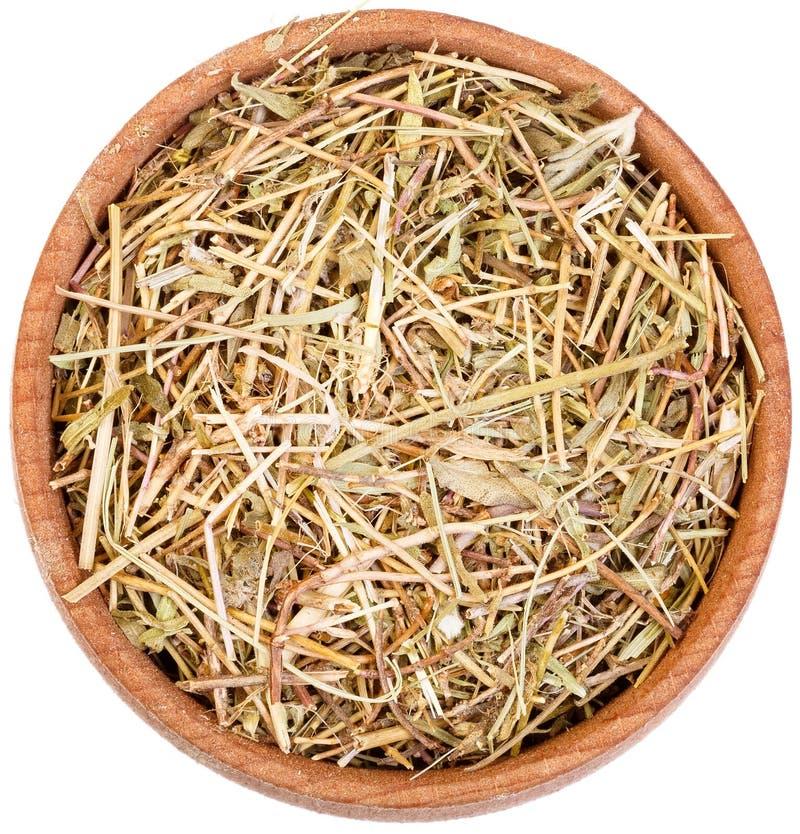 Tomilho da erva em uma curva de madeira pequena isolada no branco fotografia de stock royalty free