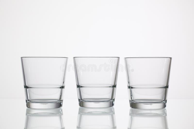 Tomma exponeringsglas av vatten royaltyfri fotografi