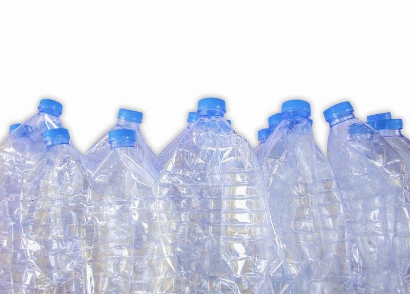 Tomma plast- flaskor av vatten för återanvänder, isolerar på vit bakgrund fotografering för bildbyråer