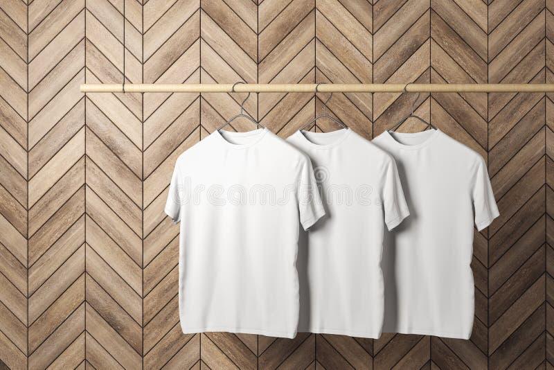 Tomma tre vita tshirts royaltyfri illustrationer