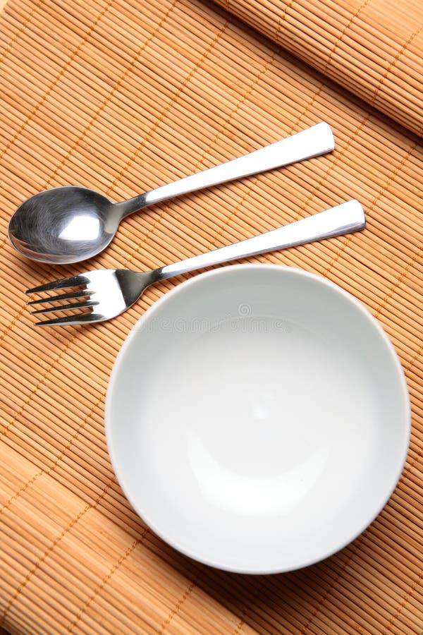 tomma utensils för bunke arkivbild