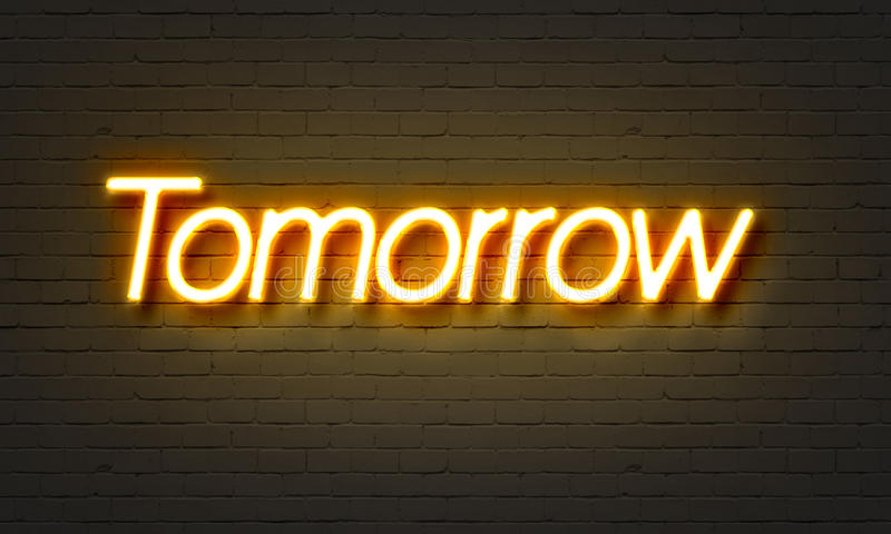 Tomorrow neon sign on brick wall background. Tomorrow neon sign on brick wall background royalty free stock photos