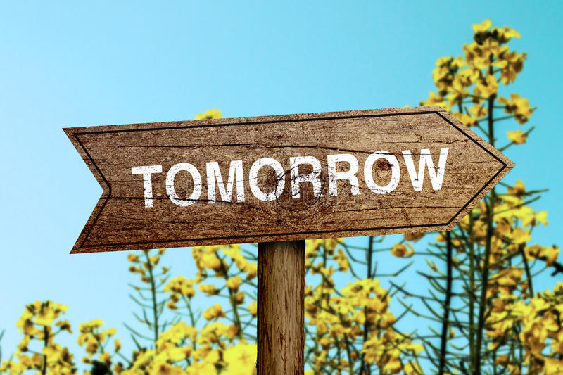 Tomorrow roadsign. Tomorrow wooden roadsign with beautiful natural background royalty free stock photos