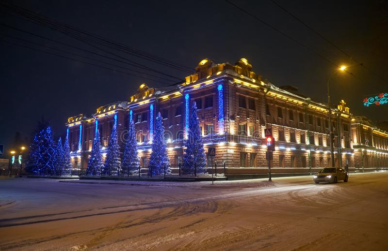 Administrative building, the former provincial classical male gymnasium dressed up Christmas lights in Tomsk royalty free stock photography