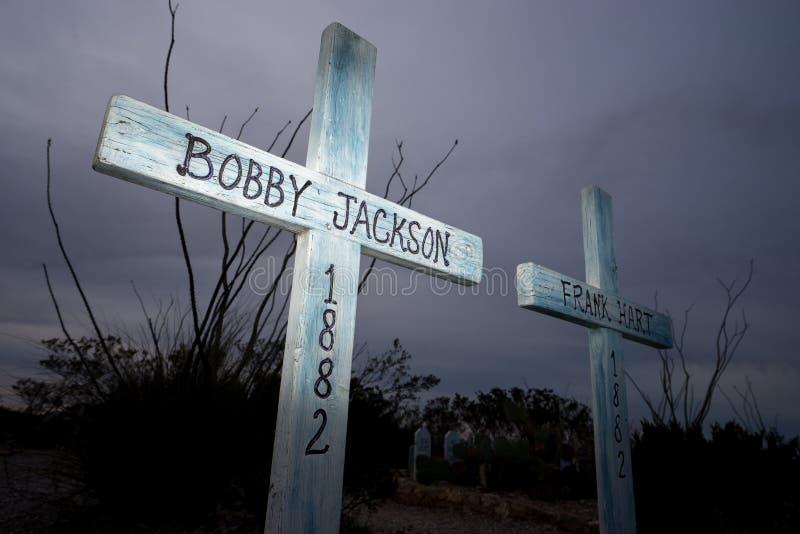 Tomstone graveyard crosses at dusk stock photo