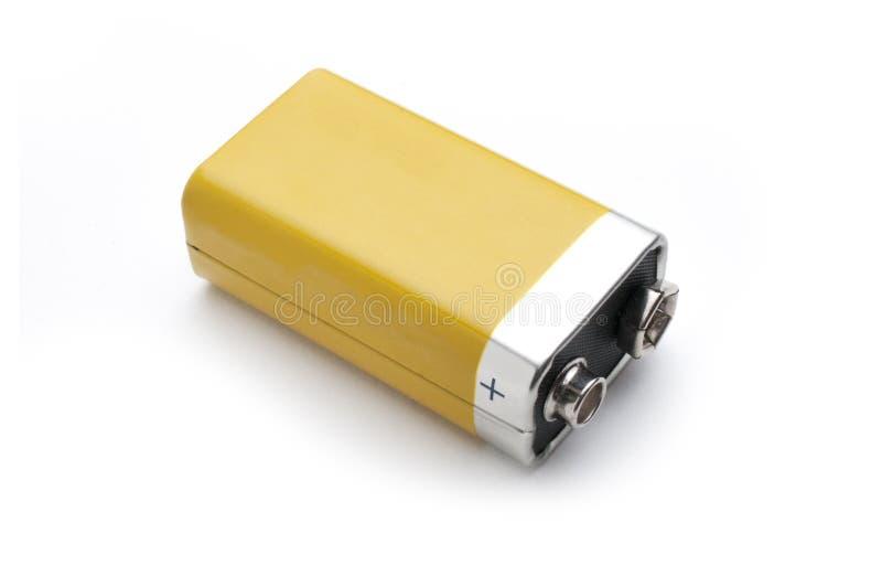 Tomt batteri som 9v isoleras på vit bakgrund arkivbilder