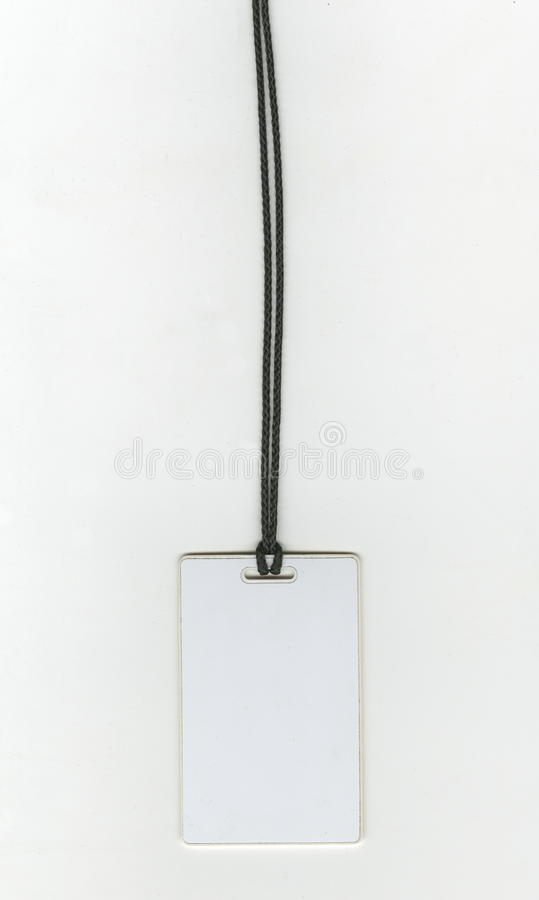 Tomt identitetskort, nyckel- kort, emblem på en svart kabel arkivfoto