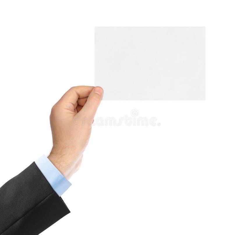 Tomt pappers- kort i hand fotografering för bildbyråer