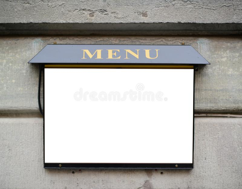 Tomt restaurangmenytecken p? v?ggen royaltyfri fotografi