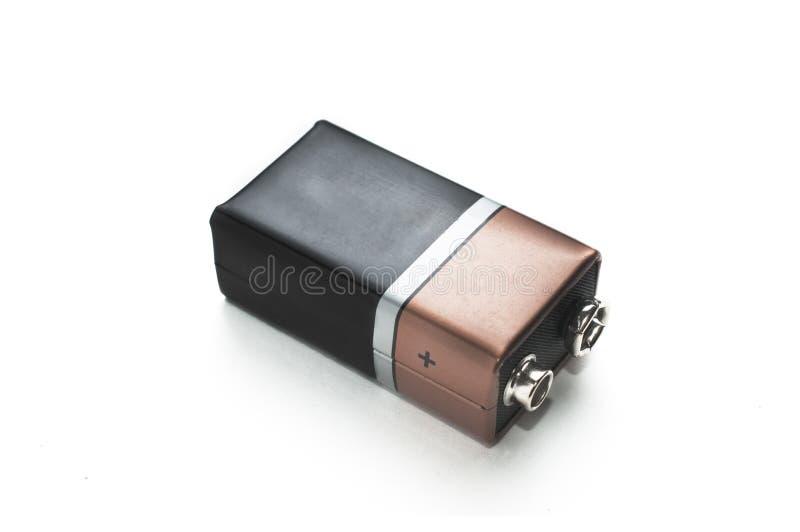 Tomt svart och kopparbatteri 9v på vit bakgrund arkivfoto