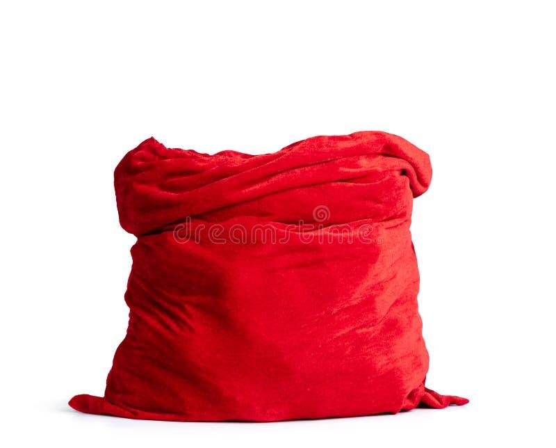 Tomten Claus öppna röda påse full, isolerad på vit bakgrund Filen innehåller en sökväg till isolering arkivfoto