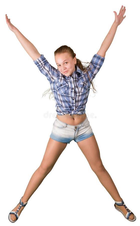 Tonårig flicka, i att hoppa för kortslutningar som isoleras på vit bakgrund fotografering för bildbyråer