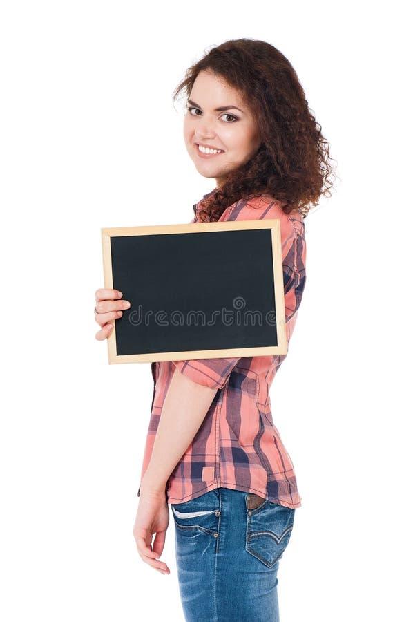 Tonårig flicka med den lilla svart tavla arkivfoton