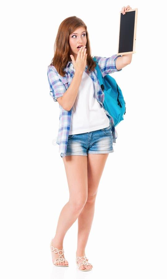 Tonårig flicka med den lilla svart tavla royaltyfri bild