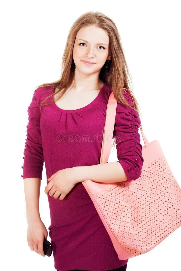 Tonårig flicka med en påse royaltyfria bilder