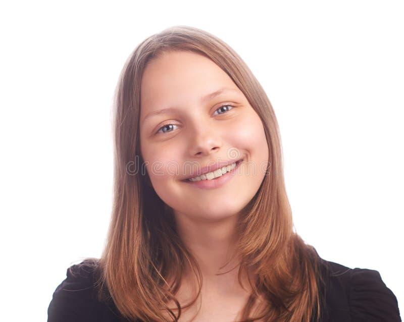 Tonårig flicka som gör roliga framsidor på vit bakgrund royaltyfri bild