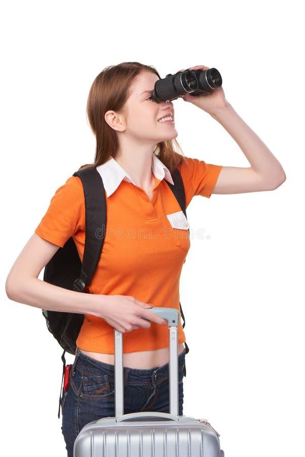 Tonårig flicka som ser till och med kikare arkivfoton
