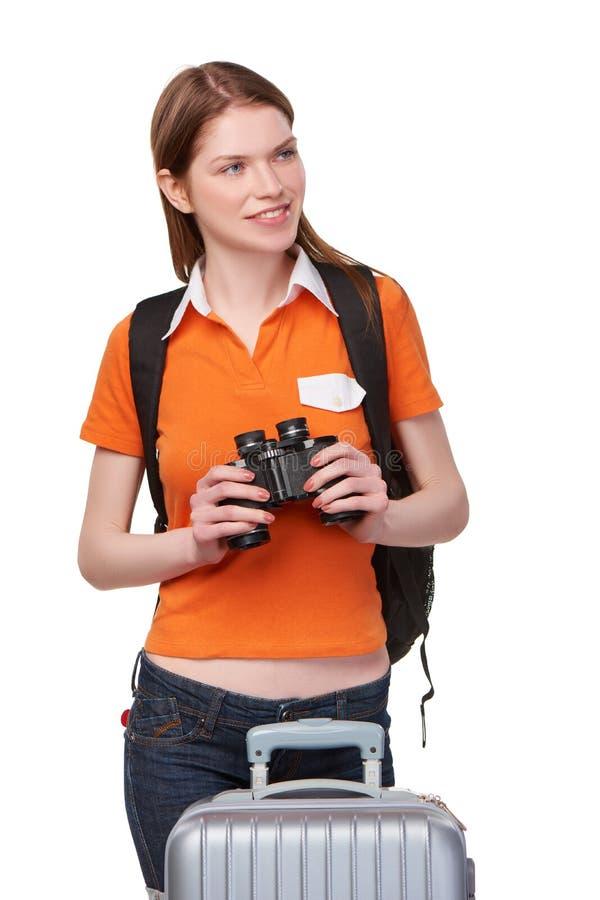 Tonårig flicka som ser till och med kikare royaltyfri fotografi