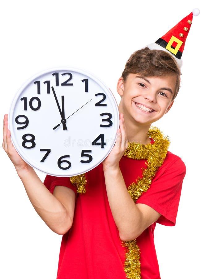 Tonårig pojke med julhatten arkivbilder