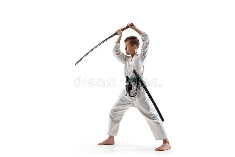 Tonårig pojkestridighet på aikidoutbildning i kampsportskola royaltyfri fotografi
