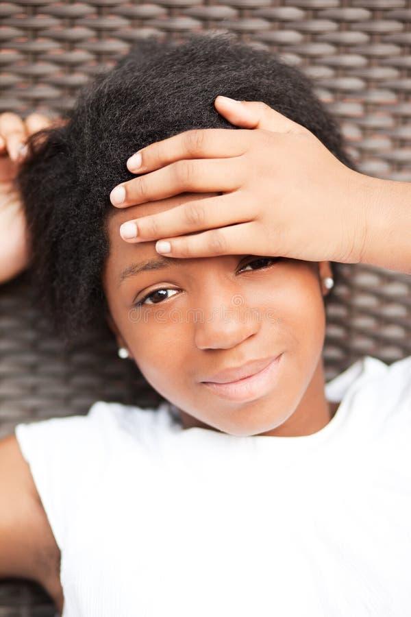 Tonårig svart flicka royaltyfri foto