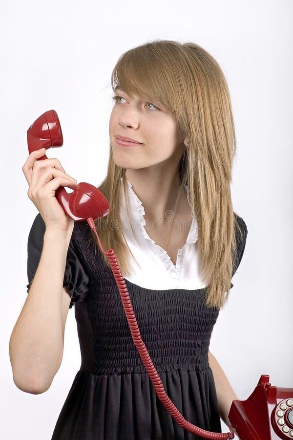 tonåring för flickatelefonred royaltyfri foto