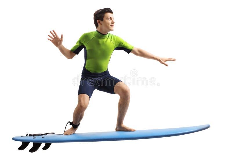 Tonåring i surfa för wetsuit fotografering för bildbyråer