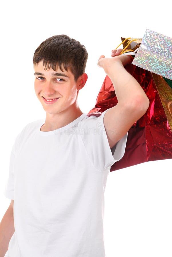 Tonåring med shoppingpåsar royaltyfria bilder