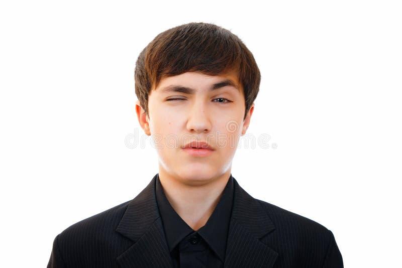 Tonåringen visar en framsida av likgiltighet, begrundande royaltyfri foto