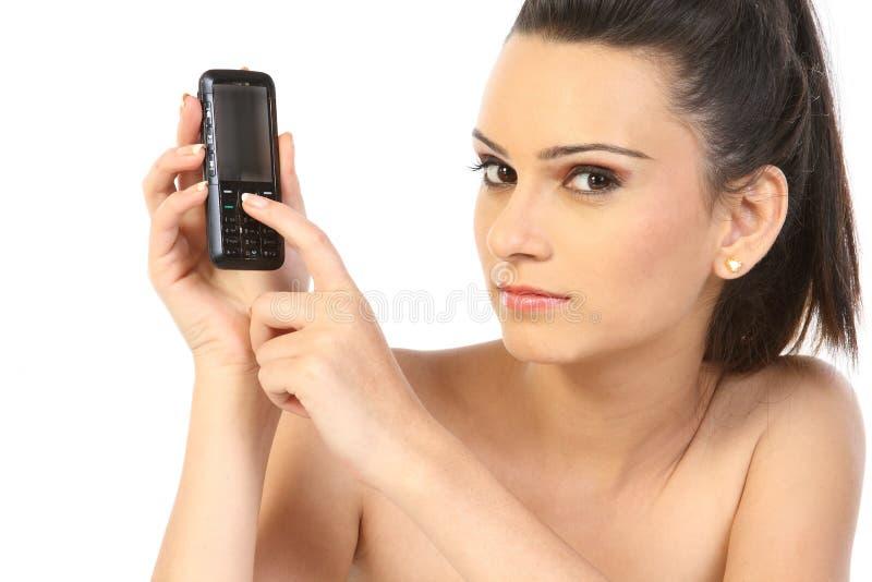 tonårs- cellflickatelefon royaltyfri foto