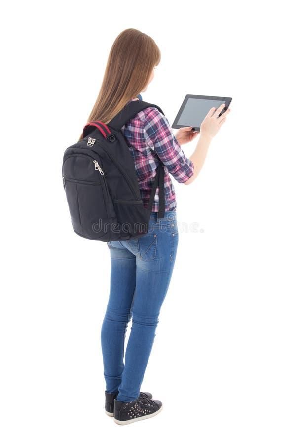 Tonårs- flicka som använder minnestavladatoren som isoleras på vit arkivbilder