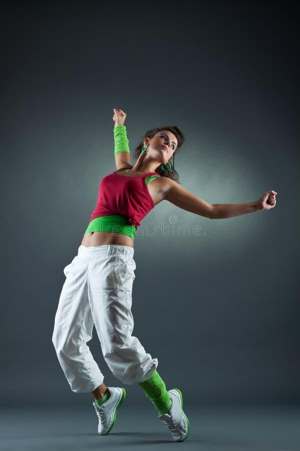 tonårs- flygtur för dansflickahöft arkivbilder