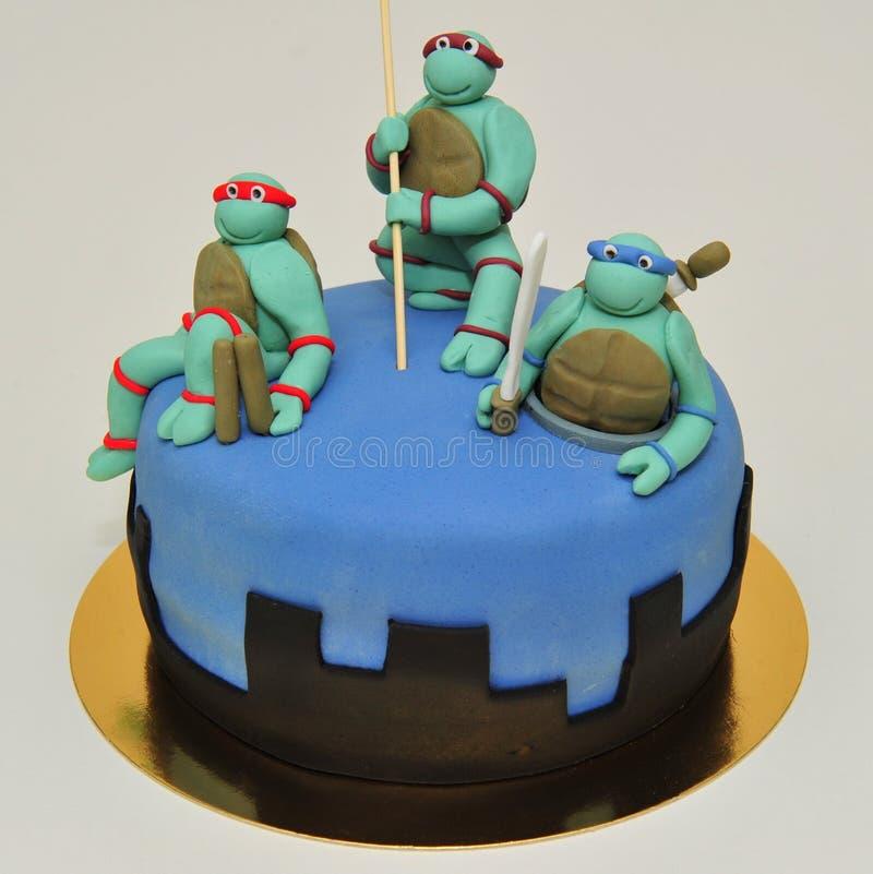 Tonårs- Ninja Mutant Turtles kaka arkivbild