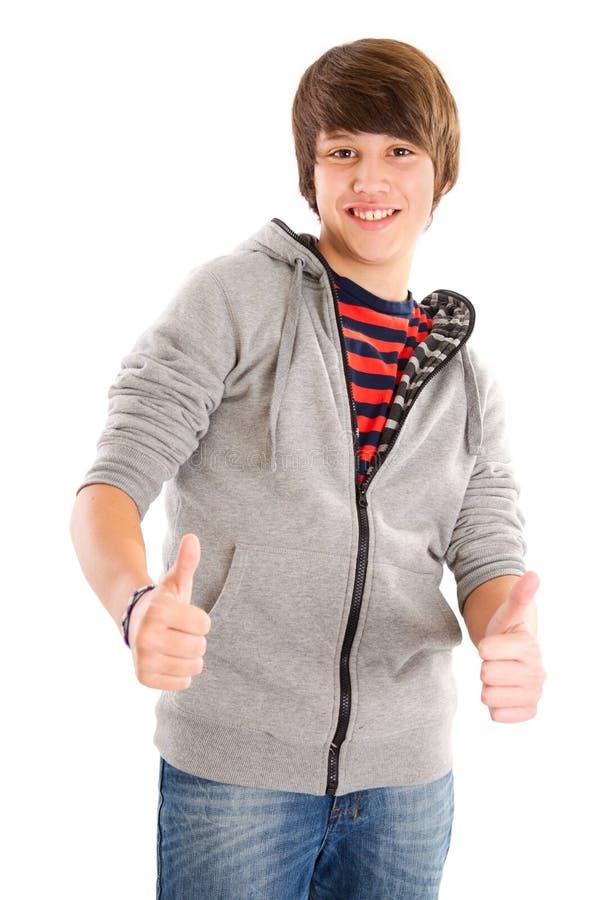 Tonårs- pojke med tummen upp arkivbilder