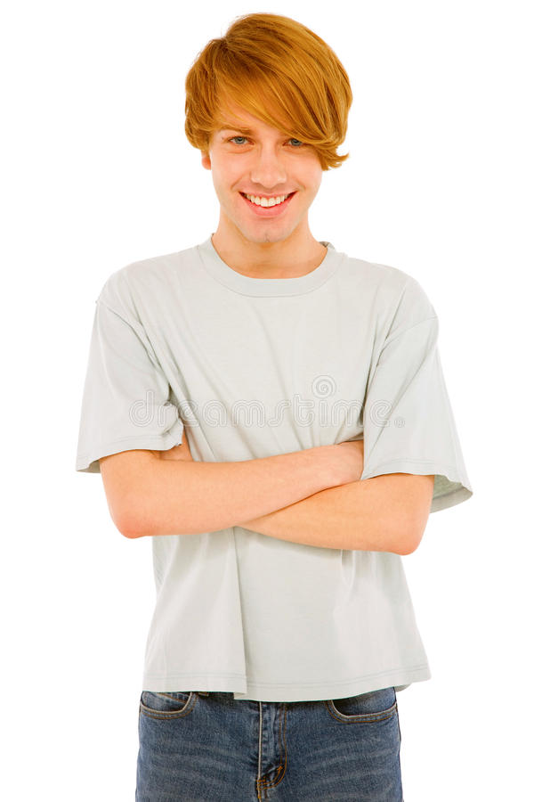 Tonårs- pojke med vikta armar arkivbild