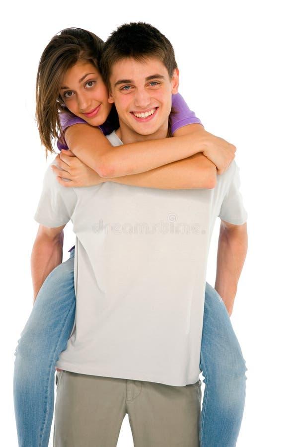 Tonårs- pojke som piggybacking den tonårs- flickan fotografering för bildbyråer