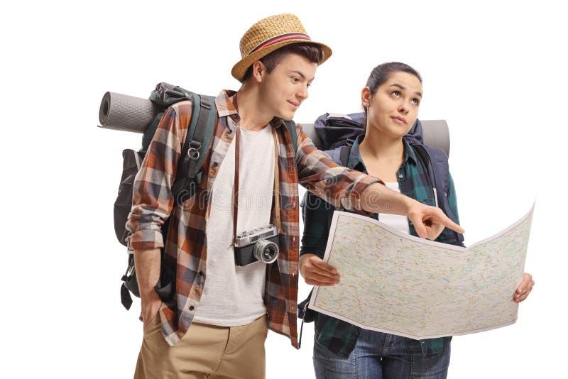 Tonårs- turister med en översikt arkivbilder